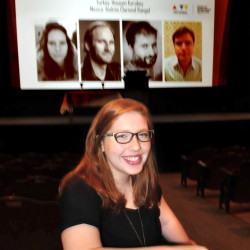 """Caroline Wheeler sits in the Waterville Opera House on Saturday as people arrive to view entries in the 38th Maine Student Film and Video Festival. Wheeler, a student at Waterville Senior High School, received an honorable mention as director of her entry, """"Three."""""""