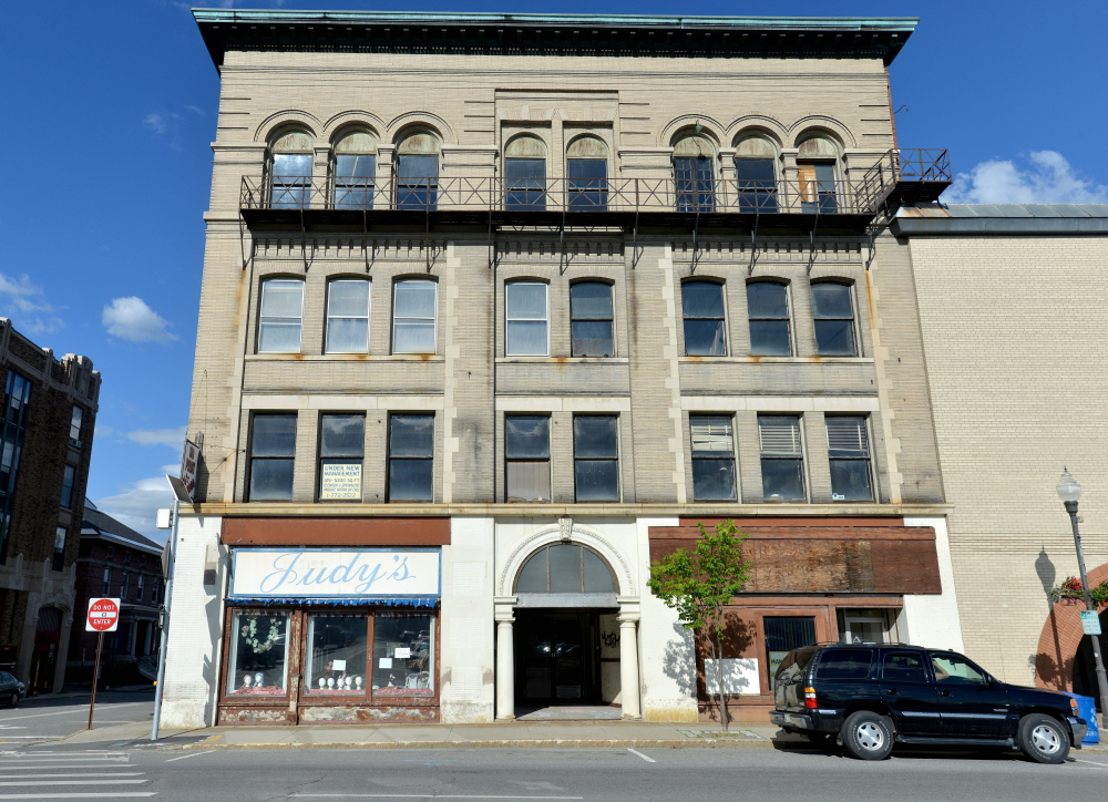 Colby College bought the long-vacant Hains Building at 173 Main St. in Waterville on Wednesday. It plans to develop it, as well as the Levine's building, which it bought July 10.