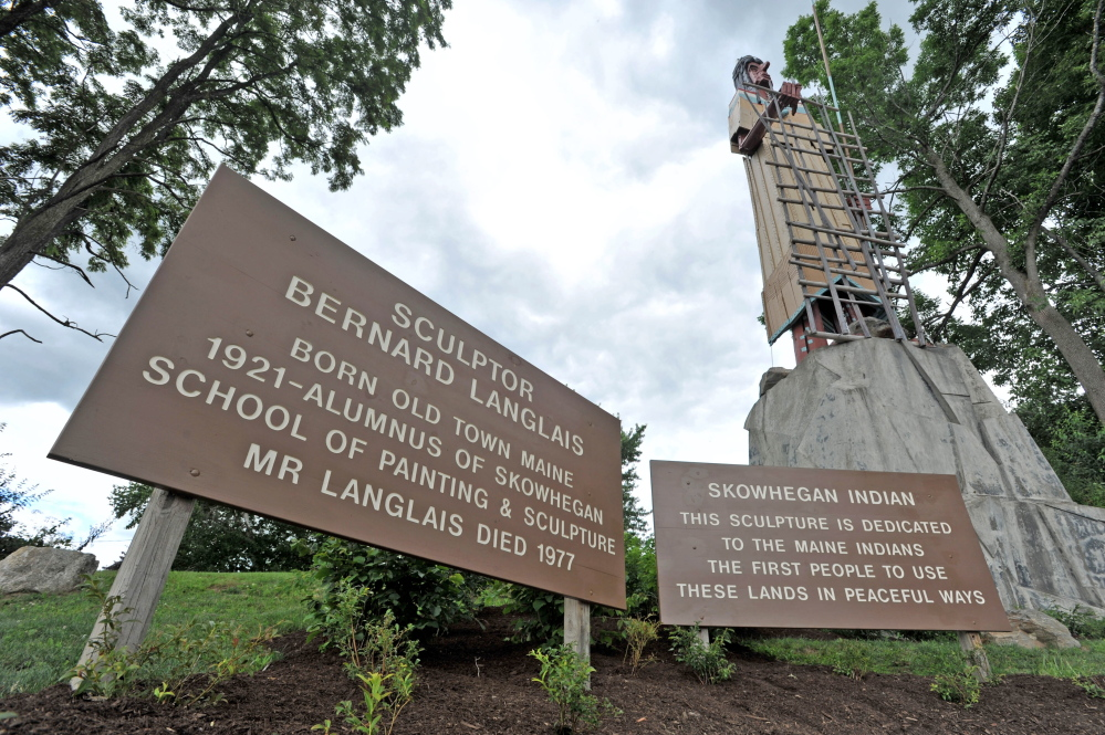 "Langlais Park in Skowhegan, at the base of the Bernard Langlais Indian sculpture, will be dedicated in a ceremony Saturday. Skowhegan police are investigating an online threat, calling for the sculpture to be burned down in protest of those who want ""Indians"" removed as Skowhegan Area High School's mascot."