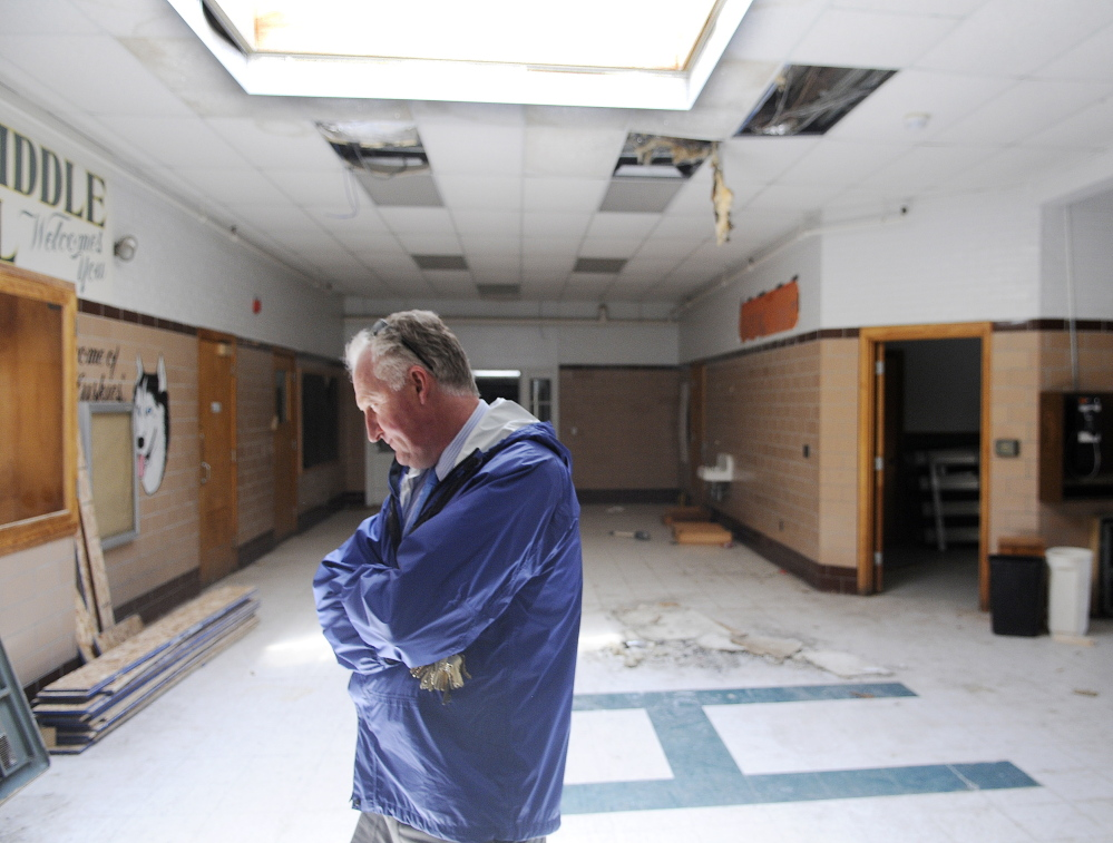 City of Augusta Facilities Manager Bob LaBreck enters the lobby of the former Hodgkins Middle School in Augusta. The Augusta Housing Authority and a local developer plan to redevelop the abandoned building into senior housing.