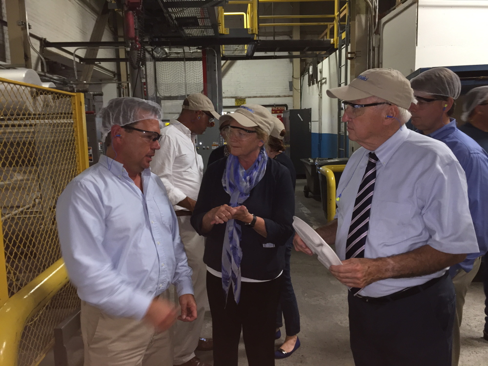 U.S. Rep. Chellie Pingree, D-1st District, and USDA Under Secretary for Food and Nutrition Kevin Concannon, right, talk to Michael Wadsworth, production manager at Huhtamaki plant, during a tour Monday. The Waterville fiber manufacturer is supplying compostable lunch plates to six of the nation's largest school districts.