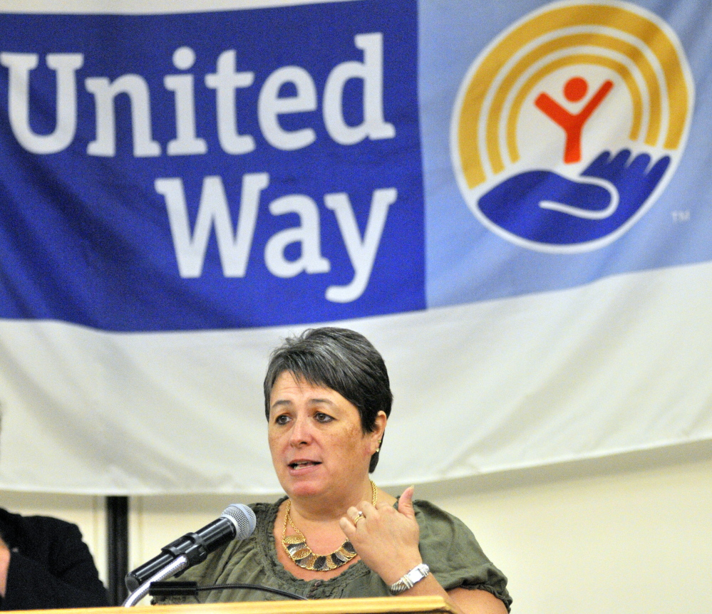 Deborah Boothby talks about surviving a fire that destroyed the Augusta apartment building her family lived in at 36 Northern Ave. last December during a salute to Augusta and Gardiner police and fire departments at the United Way of Kennebec Valley kickoff breakfast on Thursday at the Augusta Civic Center.