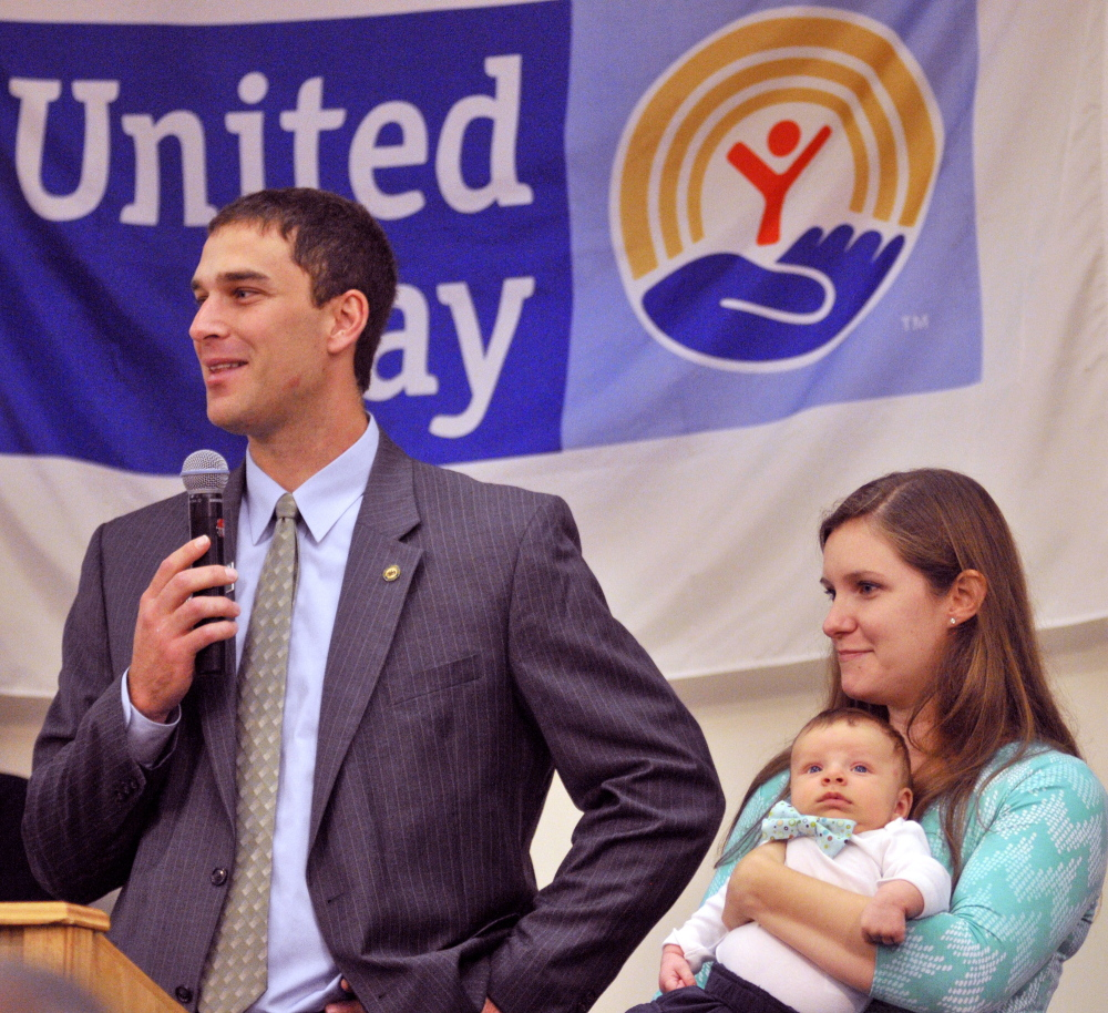 Campaign leaders Craig, left and Stephanie Garofalo, shown with their son Weston, spoke during the United Way of Kennebec Valley kickoff breakfast on Thursday at the Augusta Civic Center.