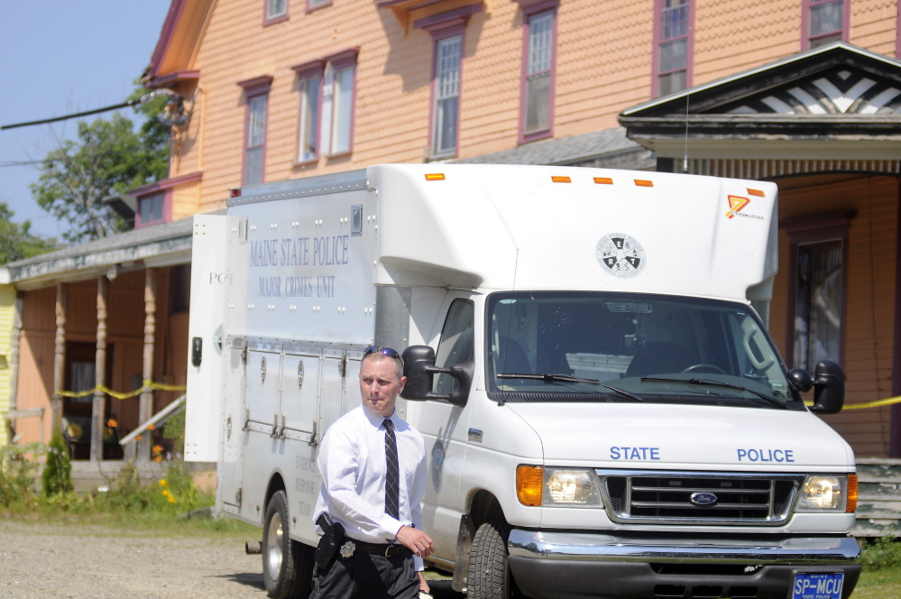 A Maine State Police detective walks out of the driveway of a East Pittston boarding home on Aug.16, 2015, following the fatal stabbing there the previous day of 51-year-old Dale Clifford.