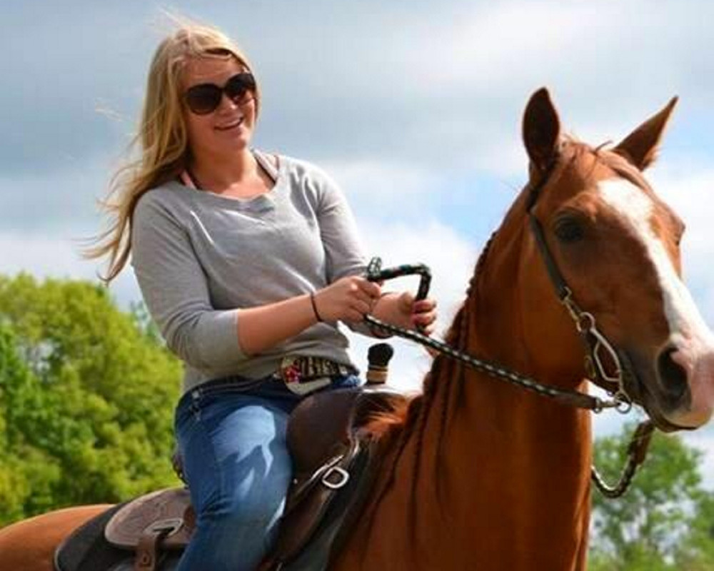 Halee Cummings and one of her horses. The Sidney teen, who died in an ATV accident Friday, loved horses and was a competitive barrel racer.
