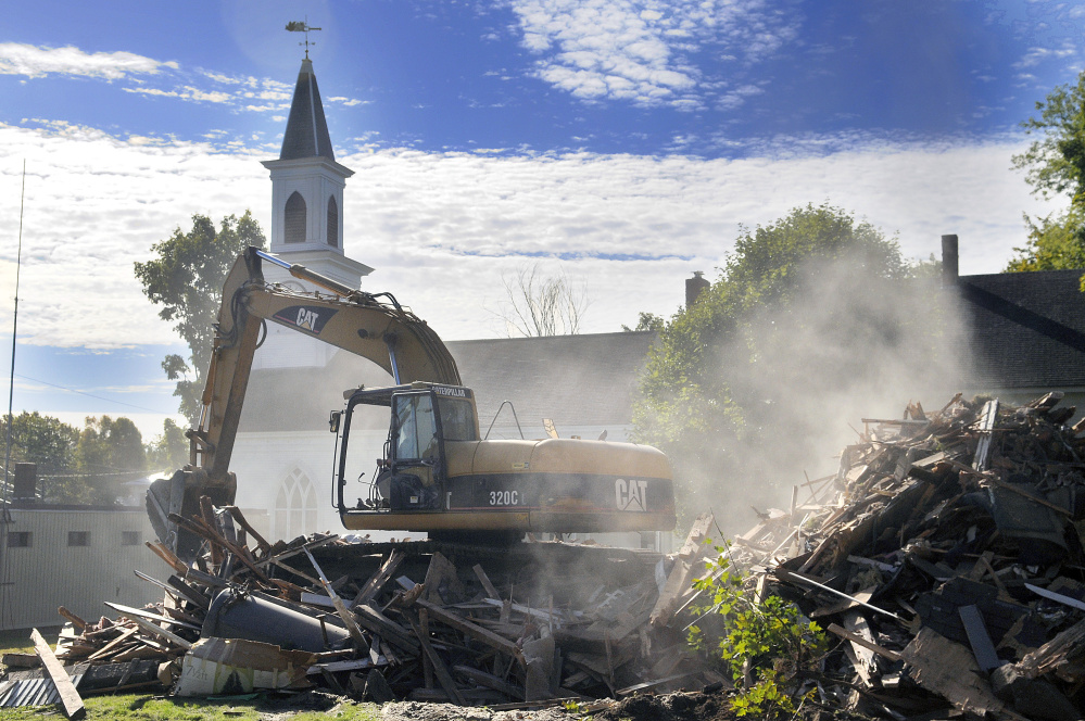 The parsonage at the Dresden Richmond United Methodist Church in downtown Richmond was torn down Monday.