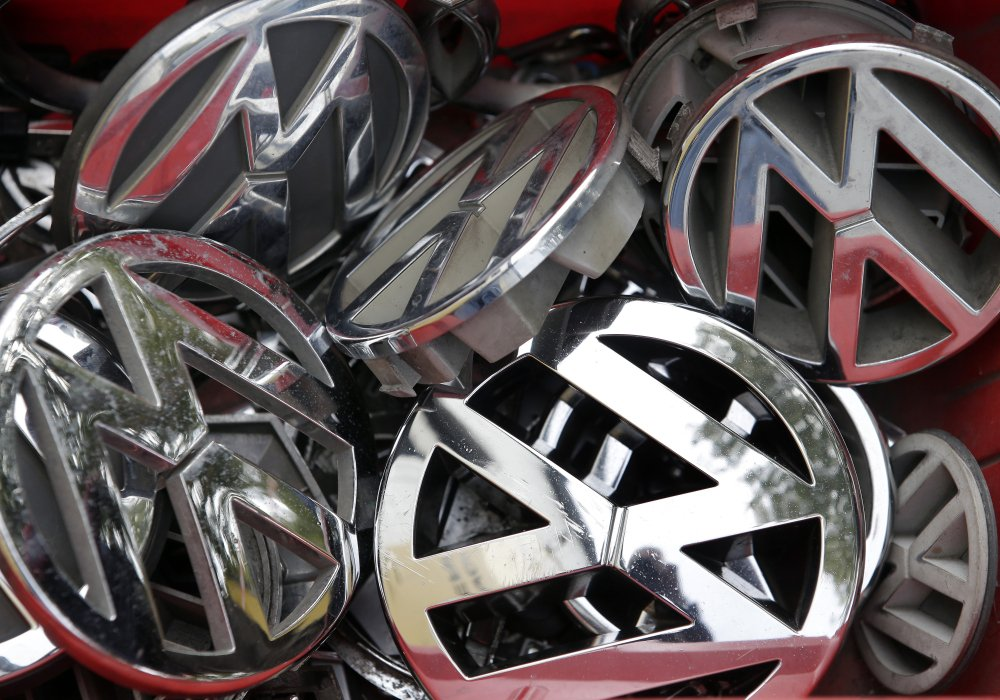 Company logos of the German car manufacturer Volkswagen sit in a box at a scrap yard recently in Berlin, Germany.