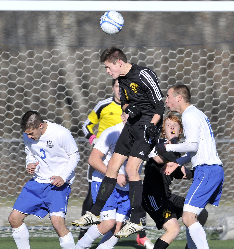 Maranacook's Kent Mohlar (13) elevates to head the ball off a corner kick in front of the Madawaska goal in the Class C state championship game last season at Hampden Academy.