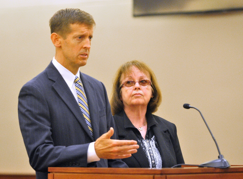 Attorney Walt McKee stands with Claudia Viles as she pleads not guilty Sept. 17 during an initial appearance in Kennebec County criminal court in Augusta. She is charged with 13 counts related to tax fraud at the Anson Town Office.