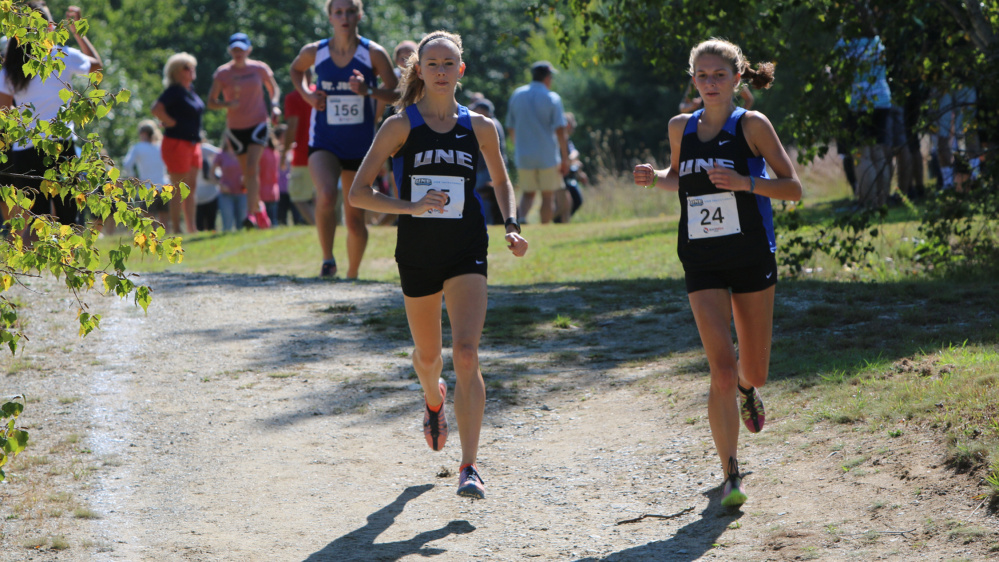 Contributed photo/UNE athletics   Tiana Thomas, left, a 2013 Waterville Senior High School graduate, competes on the University of New England cross country team. She hopes to qualify for the NCAA championship meet.