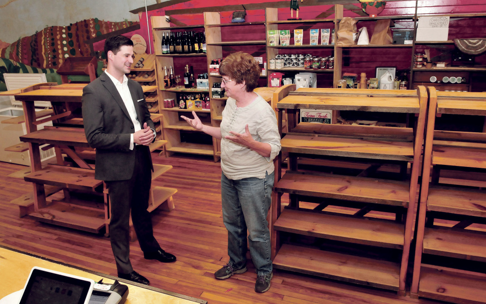 Waterville Mayor Nick Isgro and Holy Cannoli owner Candace Savinelli converse on Monday in the former Barrels Community Market store in Waterville. The two plan to open an Italian market in the closed store.