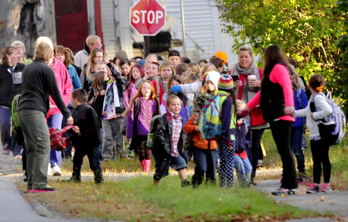 Solon Elementary School students, teachers and parents took part in a Walking School Bus Tuesday, in which they gathered in town and walked down to school.
