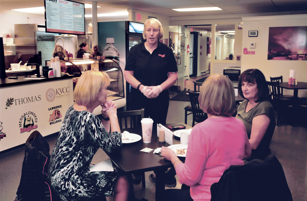 Toast XPress owner Cindy Scott speaks with customers from left, Roxanne Perrault, Terry Hiltz and Susan Tuthill at the diner early Thursday.