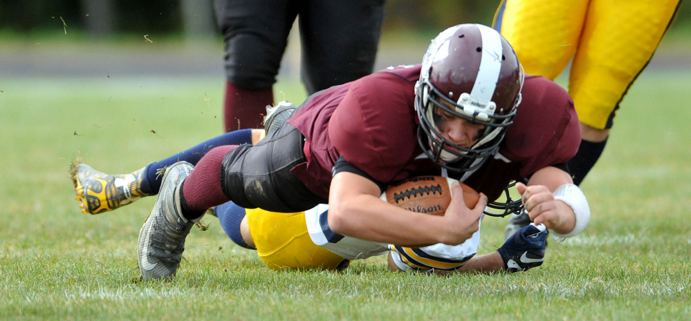 Nokomis High School's Brock Graves (12) dives for extra yards against Mt. Blue High School on Saturday in Newport.