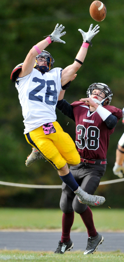 Mt. Blue High School's Christian Whitney (28) nearly intercepts a pass intended for Nokomis High School's Tyler Provencher (38) on Saturday in Newport.