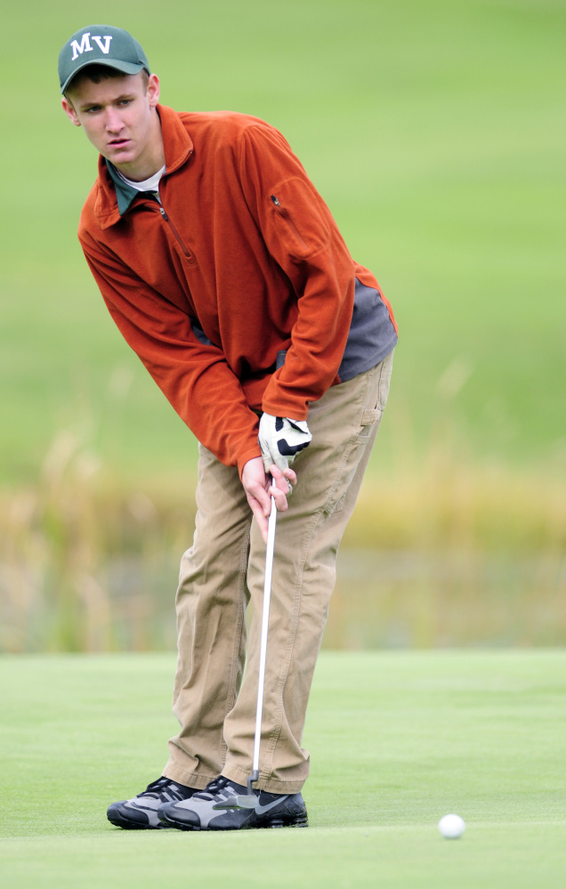Mount View's Joey Danna putts on the18th green of Tomahawk during the state team golf tournament Saturday at Natanis Golf Club in Vassalboro.