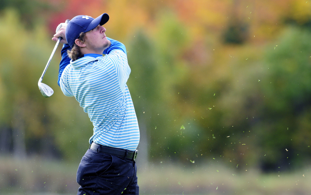 Messalonskee's Billy Rollins hits on the third fairway of Tomahawk during the state team golf tournament Saturday at Natanis Golf Club in Vassalboro.