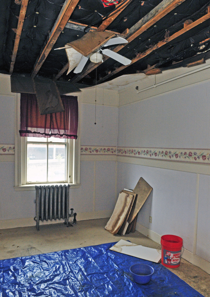 A collapsed ceiling shows evidence of a leaky roof at 287 Water St. in Augusta.