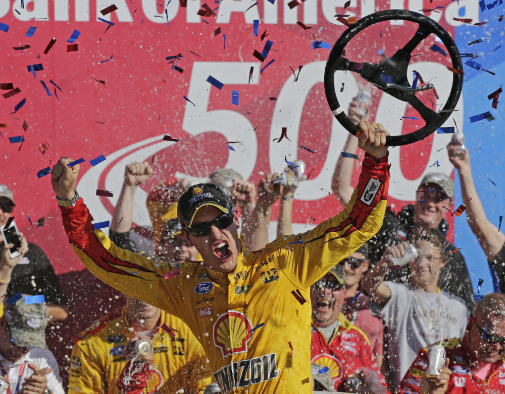 Joey Logano celebrates in Victory Lane after winning the Bank of America 500 at Charlotte Motor Speedway on Sunday in Concord, N.C.