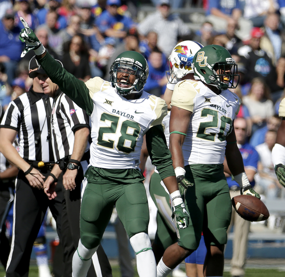 AP photo Baylor safety Orion Stewart (28) and linebacker Aiavion Edwards (20) celebrate after Edwards recovered a Kansas fumble during the first half Saturday in Lawrence, Kan. Baylor won 66-7. The Bears are No. 2 in the AP poll, their highest-ever ranking.