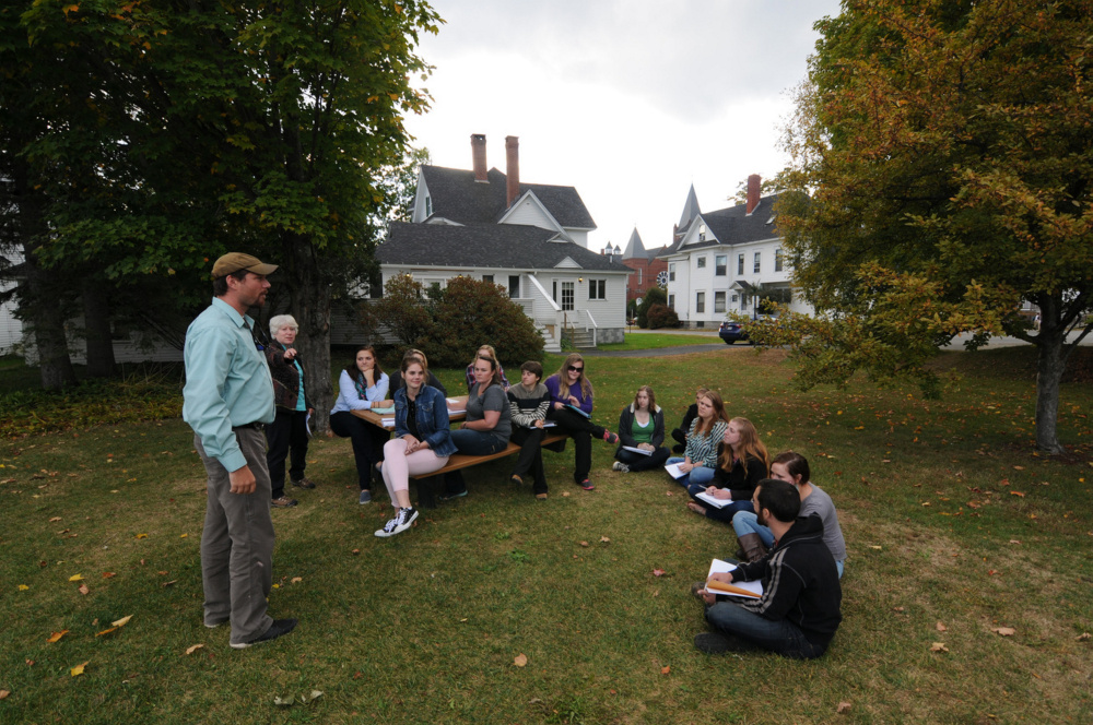 Professor Patti Bailie's students meet with UMF facilities management director Jeff McKay to conceptualize plans for a nature-based play area for the college's early education program.