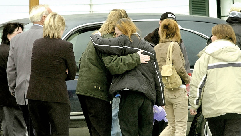 Mourners hug after Amy Drake's funeral in December 2006 in Skowhegan. Drake's body was found Nov. 24, 2006, two months after she was last seen. Police have never named a suspect, but say the case remains active.