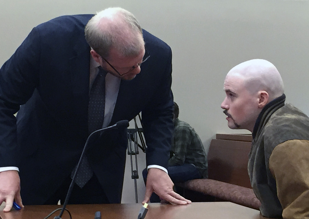 Attorney Scott Hess confers with his client, Leroy Smith III, during a hearing in December in Augusta about whether he could be forced to take psychiatric medication.