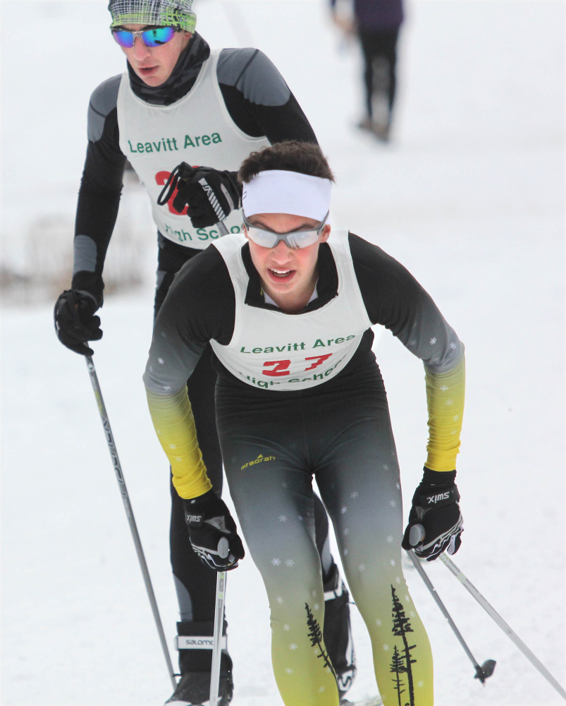 Maranacook's Luca DeAngelis pushes ahead of Winthrop's Scott Vincent during the Leavitt Hornet Classic at the Quarry Road Trails in Waterville on Saturday.