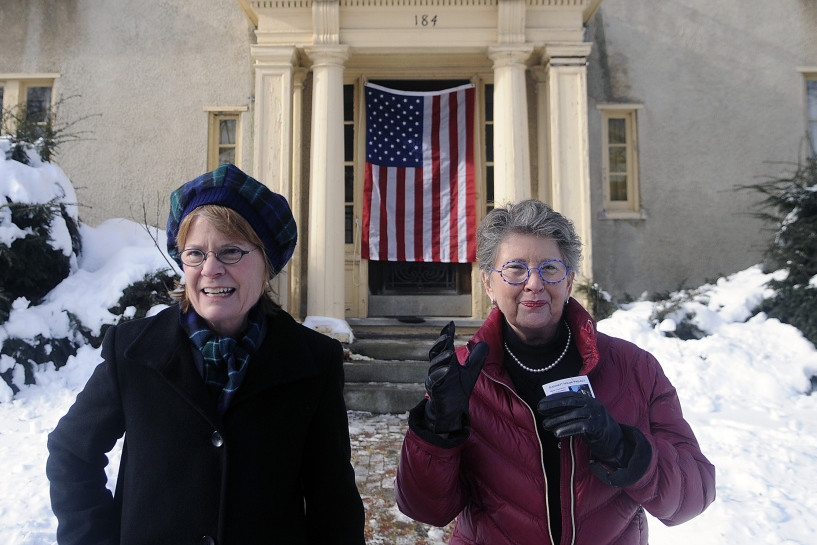 Genie, left, and Terry Gannett Hopkins exit the Gannett House in Augusta Tuesday after unveiling the colors on the entrance following an announcement by the heirs of publisher Guy Gannett that the former state office building will be converted into a First Amendment museum.