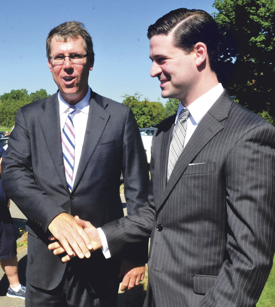 Kevin Mattson, left, owner of Dirigo Capital Advisors, greets Waterville Mayor Nick Isgro during a groundbreaking ceremony for Woodfords Family Services in Waterville on Sept. 15. Mattson said Wednesday that construction on the building, adjacent to the former Seton hospital building on Chase Avenue, will begin in April.