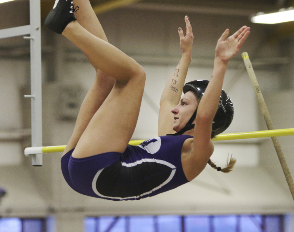 Waterville senior Alison Linscott clears the bar during the pole vault competition at the Class B state indoor track and field track championships Saturday at Bates College.