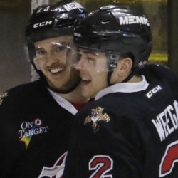 Connor Brickley is congratulated by teammate MacKenzie Weegar after scoring the go-ahead goal early in the third period Sunday against the Springfield Falcons.