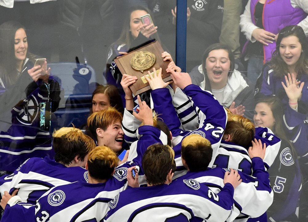 The Waterville Senior High School boys hockey team celebrates with their fans after defeating Messalonskee High school 6-2 to win the Class B North regional final Tuesday at Alfond Arena at the University of Maine at Orono.