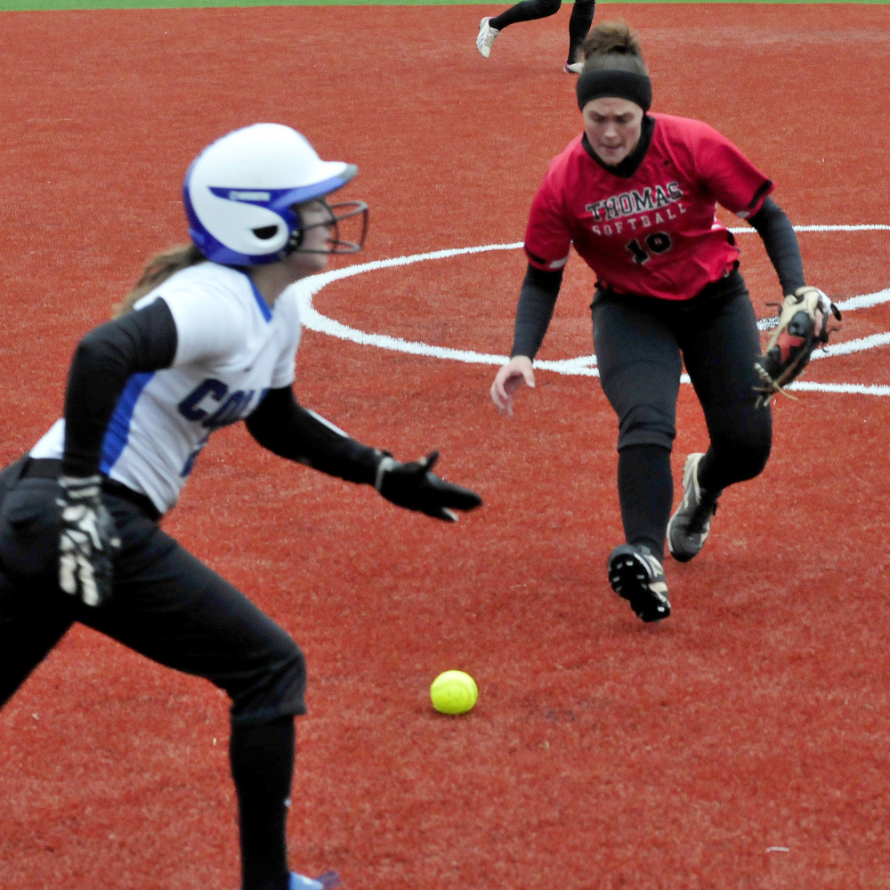 Thomas College pitcher Sonja Morse fields a bunt by Colby College player Katie McLaughlin and makes the out during a game on Monday in Waterville.