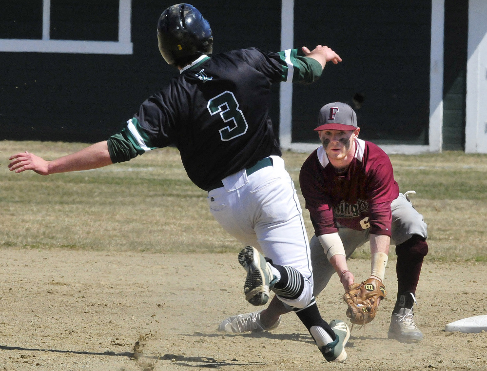 University of Maine at Farmington's Trevor Hisler waits to tag out Lyndon State's Ian Machia (3) on Sunday in Farmington.