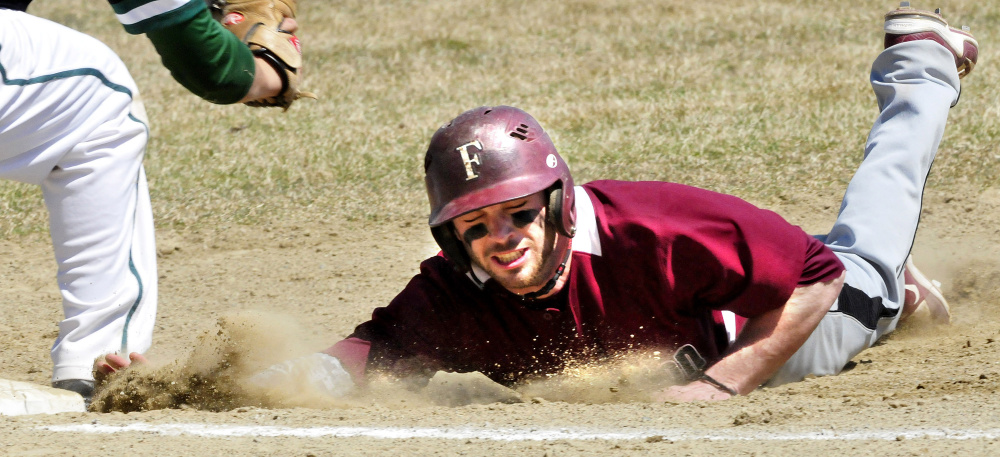 University of Maine at Farmington's Grayson Beressi makes it back to first base in time during a game against Lyndon State on Sunday in Farmington.