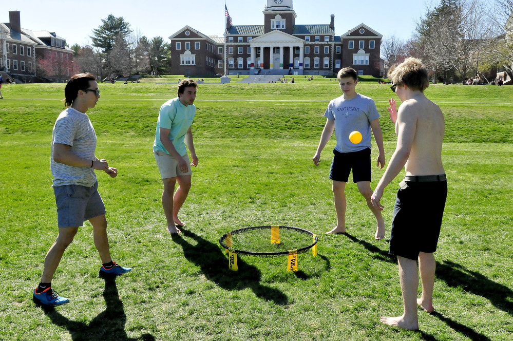 Colby College students, including this group playing spike ball, studied, relaxed and played outdoors during one of the warmest days of spring on Thursday. The college will celebrate Earth Day today with a fair featuring a clothing recycling event and T-shirt creations, and on Saturday with a concert and carnival.