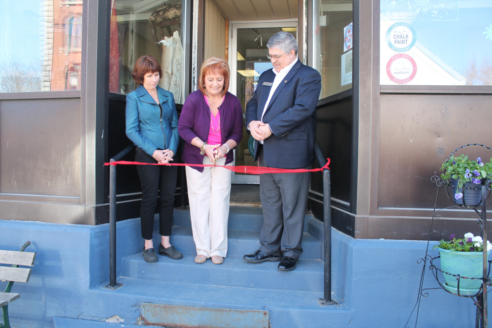 From left to right, Winthrop Lakes Region Chamber Director Barbara Walsh, Cindy Gervais, owner of Vintage Collectibles & Indoor Market, and Kennebec Valley Chamber of Commerce President Ross Cunningham recently attended the market's grand opening at 129 Main St. in Winthrop.