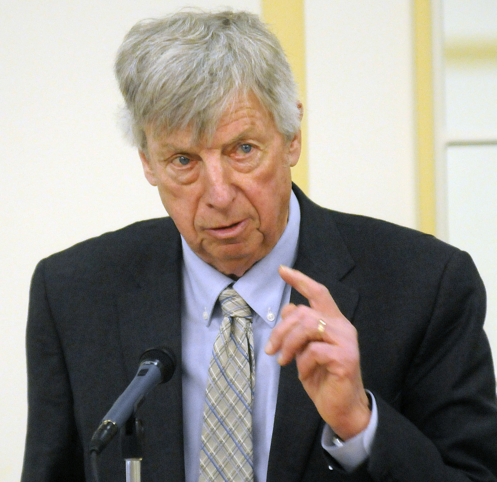 Richard Rudolf, of the Maine Rail Group, takes part in a rail summit Tuesday in Augusta.