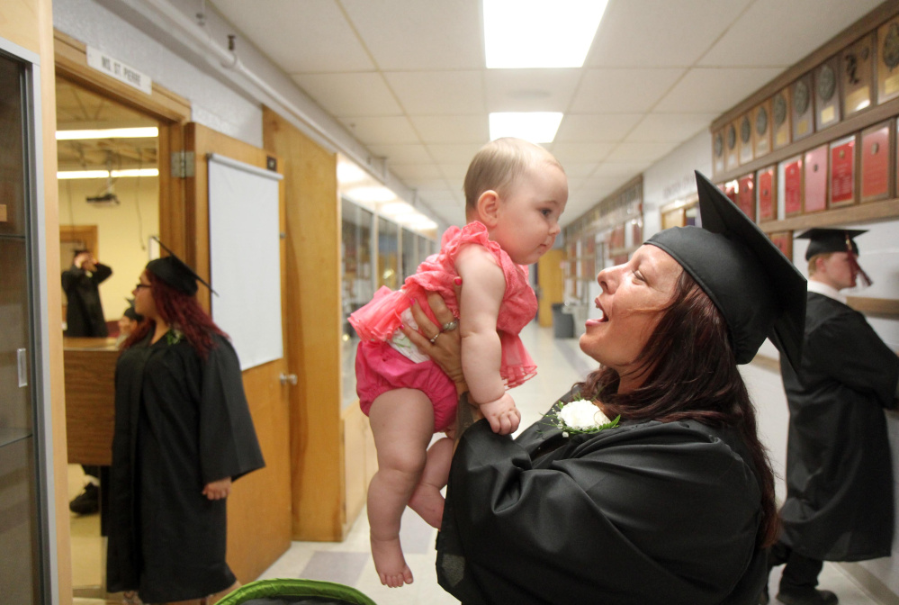 Madelaina Visconti, of Winslow, holds her granddaughter Lilly Ann Tingley before the start of the graduation ceremony Tuesday night at Mid-Maine Regional Adult Community Education at Waterville Senior High School.