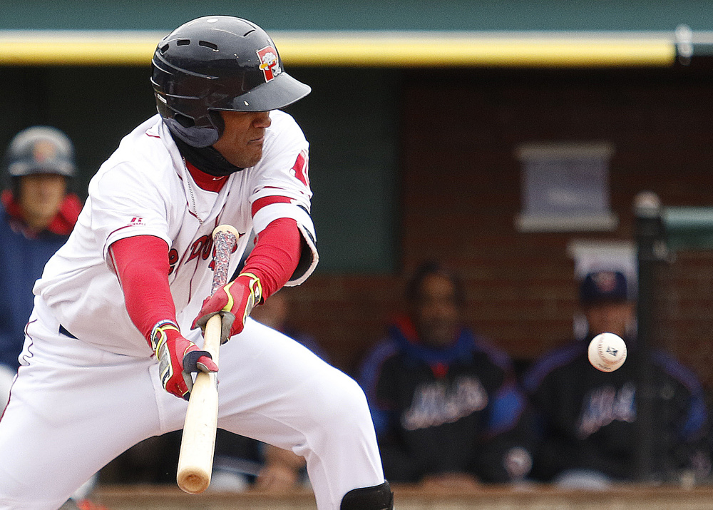 Wendell Rijo of the Portland Sea Dogs fails to get a bunt to land in fair territory Thursday during the first inning of the 2-1 victory against the Binghamton Mets at Hadlock Field. Binghamton had won 14 straight games in Portland.