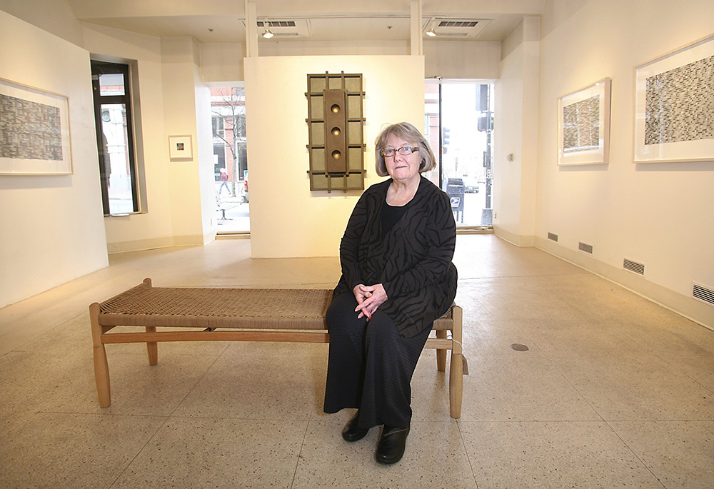 June Fitzpatrick sits in her gallery at 522 Congress St. in Portland in February 2010. Fitzpatrick was among the inaugural participants in Portland's First Friday Art Walk and is the last of the original participants still active in the monthly art event. Tim Greenway/Staff Photographer