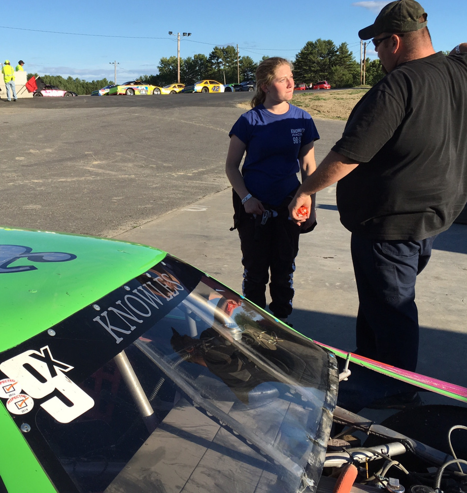 Brooke Knowles, left, of Readfield, talks with crew chief Maurice Young, of Chelsea, prior to a race at Wiscasset Speedway on July 2.