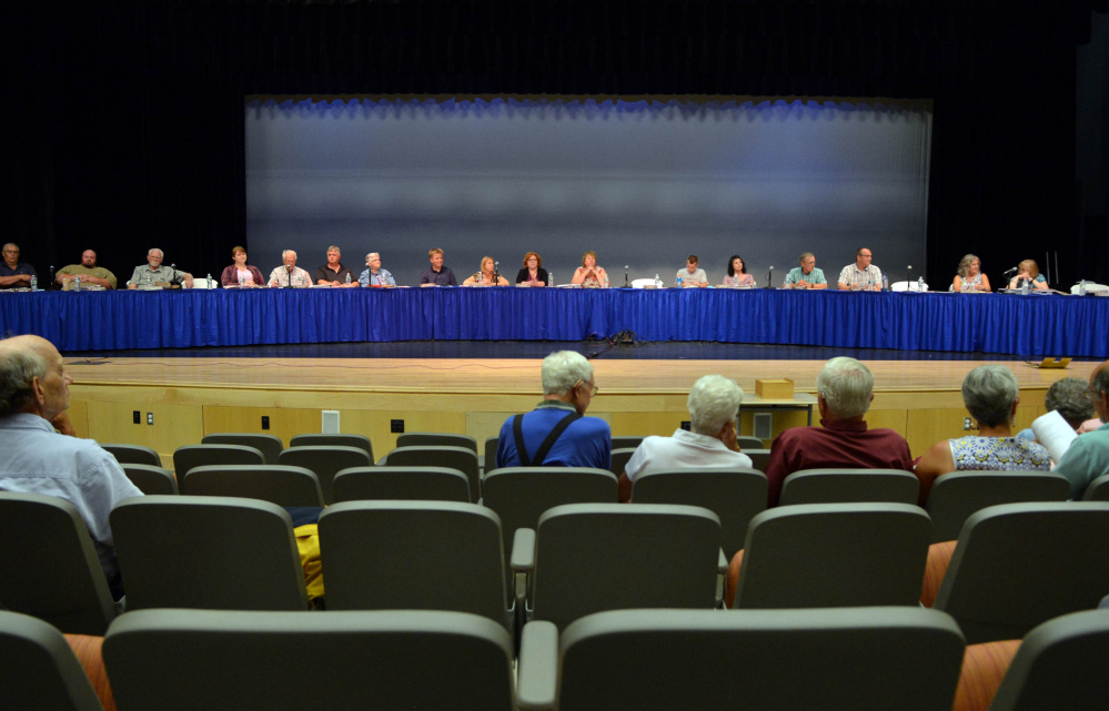 The Regional School Unit 9 board of directors presides over a districtwide school budget meeting Thursday in Bjorn Auditorium at Mt. Blue High School in Farmington.