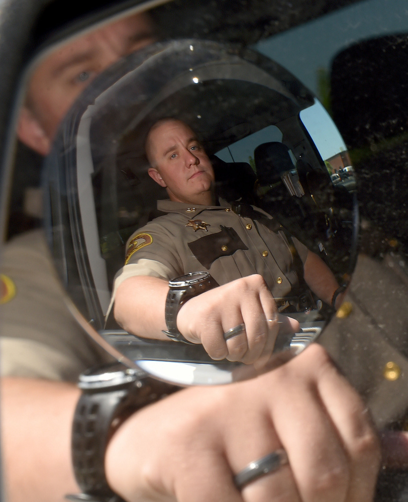 Somerset County Sheriff's Deputy Brian Crater, in his patrol vehicle Wednesday at the Somerset County Sheriff's Office in East Madison, said he intends to be part of the community as the deputy patrolling Somerset County's northern area.