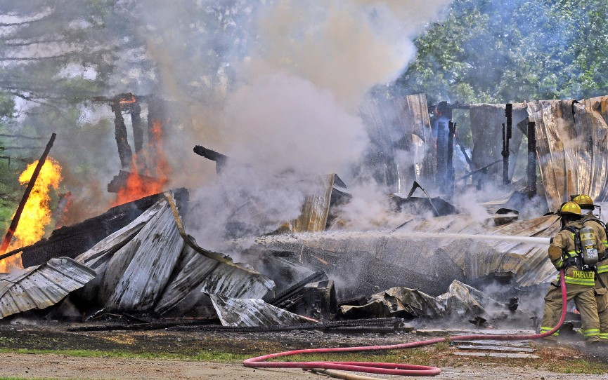 Firefighters battle a blaze Sunday at 35 Holway Road in Sidney.