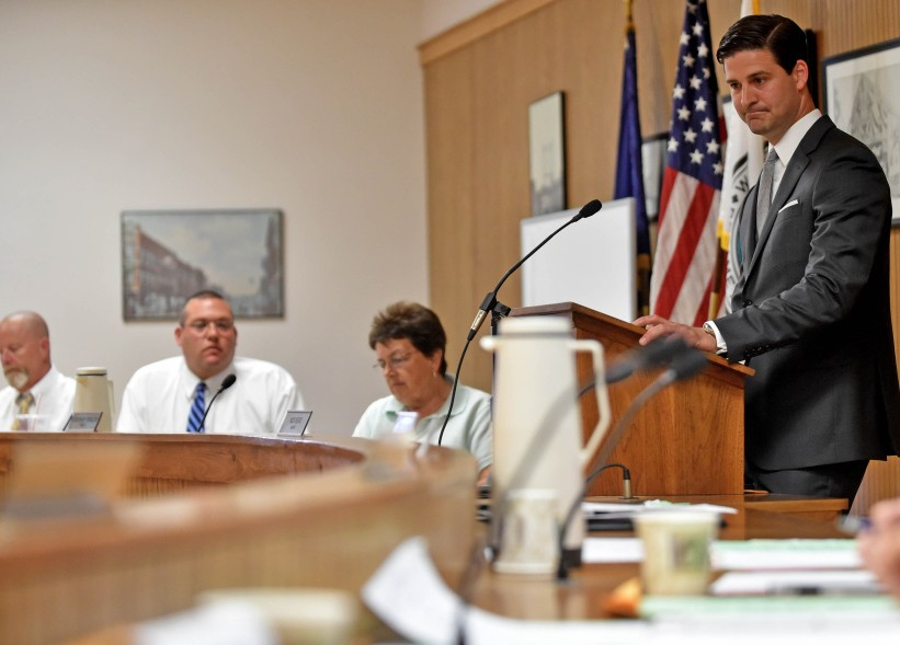 Waterville Mayor Nick Isgro, center, listens to city councilors during budget discussions June 21. Councilors on Tuesday plan to vote on whether to override Isgro's veto of the budget, following council approval earlier this month.