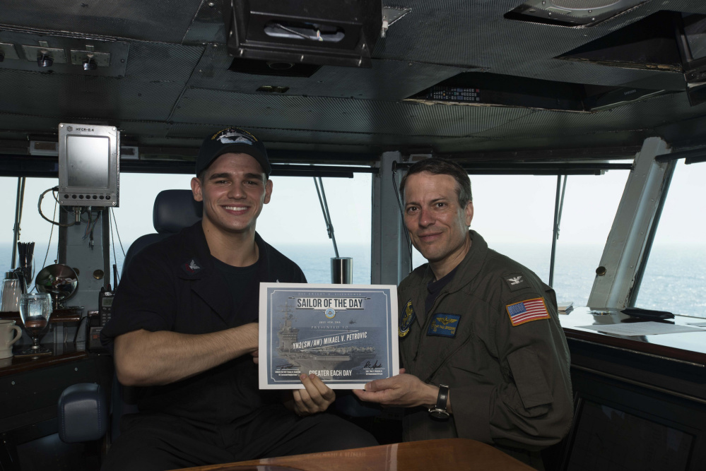 Petty Officer 2nd Class Mikael Petrovic, of Winslow, Maine, and a 2013 graduate of Winslow High School, was recently awarded Sailor of the Day aboard USS Dwight D. Eisenhower in the Mediterranean Sea by Commanding Officer, Capt. Paul C. Spedero Jr. Petrovic received the award as the only yeoman serving 600 personnel with the Carrier Air Wing Three (CVW-3)  embarked on the ship. Petrovic enlisted in the Navy in Aug. 15, 2013, and is being screened for the Chief of Naval Operations Staff in Washington, D.C.  He is the son of Robert and Jacquelyn Petrovic, of Winslow.