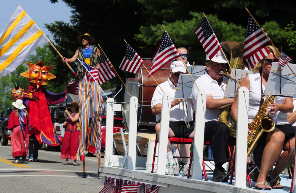 The Shoe String Theater group, left, follows the Hallowell Community Band as the 2014 Richmond Days parade heads down Main Street toward the Kennebec River. This year's Richmond Days runs Friday through Sunday with a Hawaiian theme.