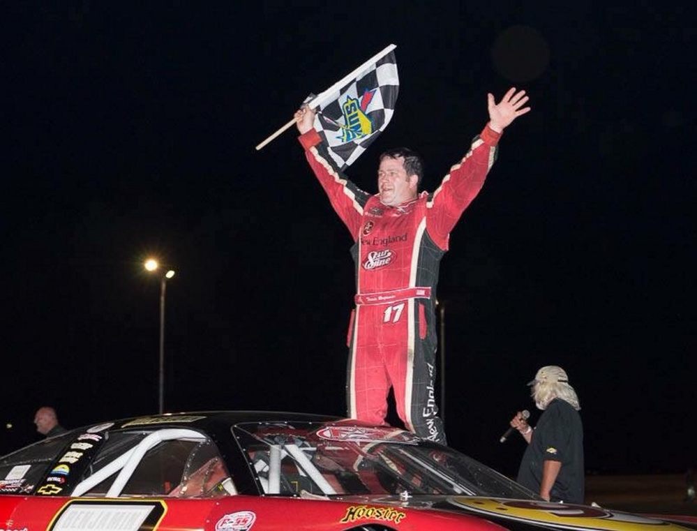Travis Benjamin, of Morrill, celebrates his Pro All Stars Series victory at Beech Ridge Motor Speedway in Scarborough on July 12.